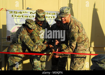 CAMP BUEHRING, Kuwait - Key leadership stationed at Camp Buehring cut the ribbon at the grand opening of the Gaining - Stock Photo