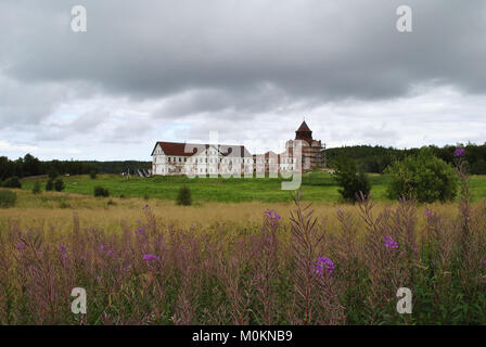 Monastery monastery on the island of Anser. The cell building and the building of the Trinity Church. Russia, Arkhangelsk - Stock Photo