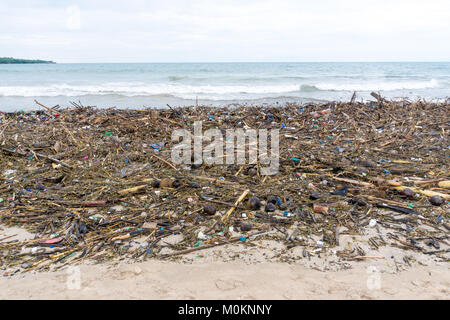 Water pollution, empty plastic bottles on ocean beach - Stock Photo