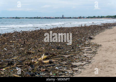 Rubbish and domestic waste polluting the beach. - Stock Photo