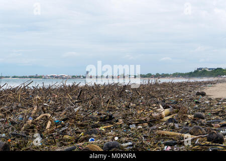 Pollution concept. Beach polluted with plastic garbage and tree branches - Stock Photo