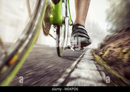 Pedal of a fast moving racing bicycle - Stock Photo