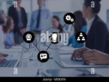 Hands in a meeting writing on computer with graph overlays - Stock Photo