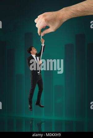 Hand choosing a man with a rope on a green background with graph - Stock Photo