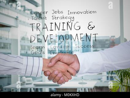 Two men shaking hands in office with plan in text behind them - Stock Photo