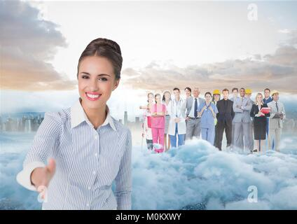 Business woman facing out with smoke, city and coworkers behind her - Stock Photo