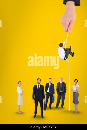Hand choosing a man with a rope on a yellow background with business people - Stock Photo