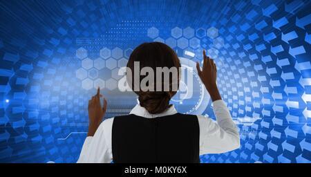 Woman touching blue interface on wall - Stock Photo