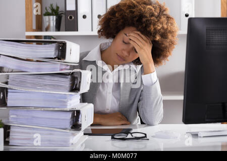 Stressful Afro American Businesswoman Sitting In Office With Stacked Of Files - Stock Photo