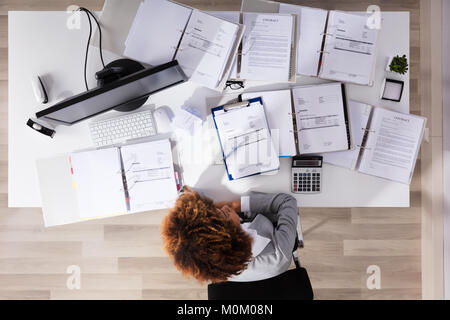 Elevated View Of Unhappy Afro American Businesswoman Sitting In Office - Stock Photo