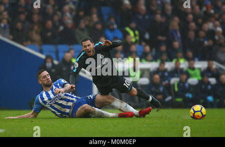 Shane Duffy of Brighton slides in to tackle Eden Hazard of Chelsea during the Premier League match between Brighton - Stock Photo