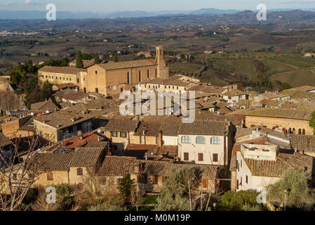 Aerial view of San Gimignano and the Church of Sant'Agostino in the afternoon light, Siena, Tuscany, Italy - Stock Photo