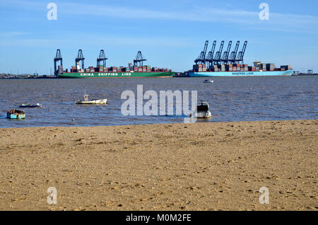 A view of the port of Felixstowe from Harwich looking across Harwich Harbour - Stock Photo