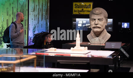 Visitors walk through the exhibition on Stalin cult in the former German Democratic Republic (GDR) at the memorial - Stock Photo