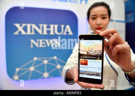 (180123) -- BEIJING, Jan. 23, 2018 (Xinhua) -- A staff member shows the Xinhua News App, in Beijing, capital of - Stock Photo