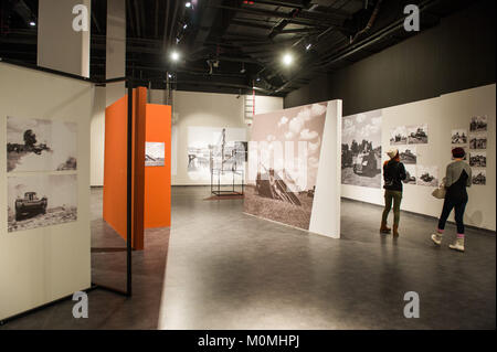 Gdansk, Poland. 23rd Jan, 2018. Visitors look at a temporary photography exhibition of Westerplatte at the World - Stock Photo