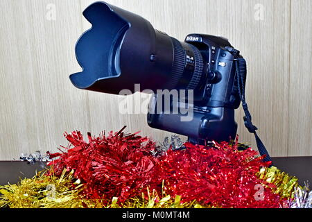 Nikon DSLR D80 and battery pack and Lenses on display and Christmas decorations as well - Stock Photo