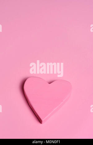 closeup of a pink three-dimensional heart on a pink background, with a blank space on top - Stock Photo