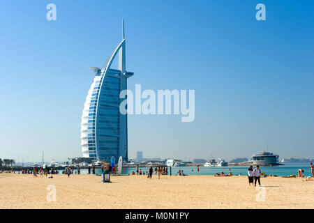 DUBAI, UNITED ARAB EMIRATES - JAN 02, 2018: Public beach of Dubai near the Burj Al Arab hotel. - Stock Photo