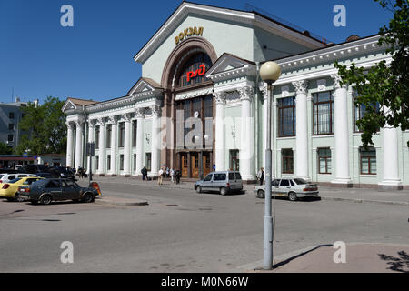 Vyborg, Leningrad oblast, Russia - June 06, 2015: People in front of the train station in a summer day. The station - Stock Photo