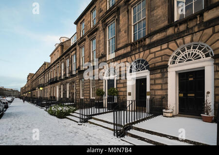View of Heriot Row street in winter with snow covering in Edinburgh New Town, Scotland, United Kingdom - Stock Photo