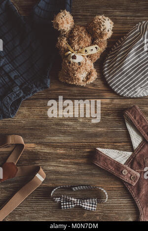 Flat lay photography of boy's casual outfits, Outfits of traveler, boy, male, Men's casual outfits on wood board - Stock Photo