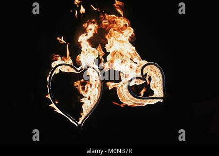 happy valentine's day card. two hearts shaped fireworks on black background, fire show in night. bengal fire burning heart. space for text. wedding or