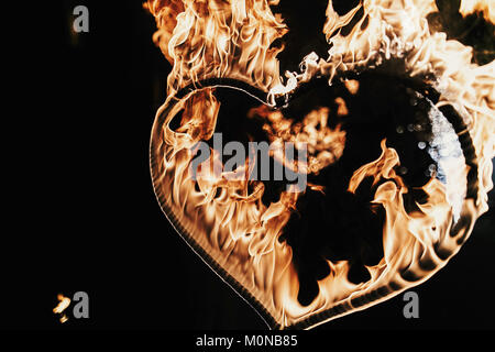 happy valentine's day card.heart shaped firework on black background, fire show in night.  bengal fire burning heart. space for text. wedding or valen