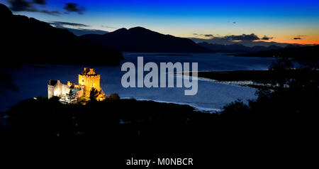 Sunset over Eilean Donan Castle and Loch Alsh - Stock Photo