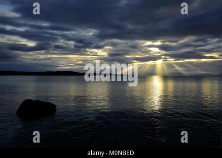 Sunset over Loch Gairloch and Skye - Stock Photo