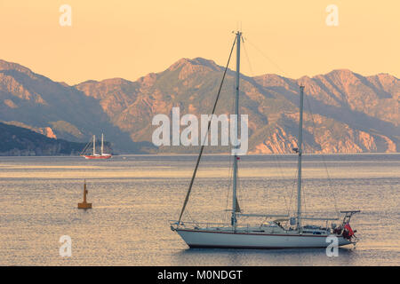 Beautiful seascape with sailing boat during sunrise in Turunc province in Marmaris, Turkey - Stock Photo