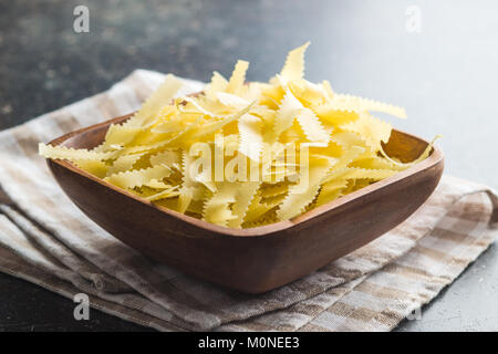Dried italian pasta in bowl. - Stock Photo