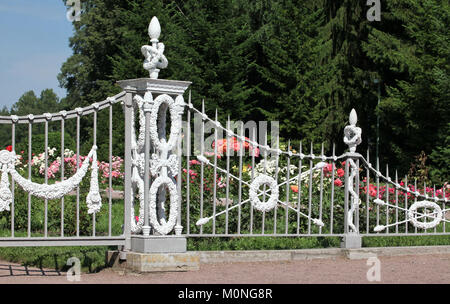 Ornate iron-wrought fence of rose garden - Stock Photo