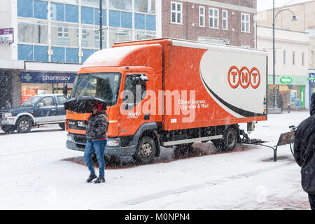 TNT Delivery Lorry delivering goods in town centre in snow blizzard. Reading, Berkshire, England, GB, UK - Stock Photo