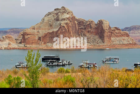 Private boats on Lake Powell by the Glen Canyon Dam near Page, Arizona. - Stock Photo