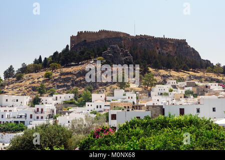 Panoramic view on Lindos town with a beautiful lagoon and ancient fortress on a hill at Rhodes island, Greec - Stock Photo