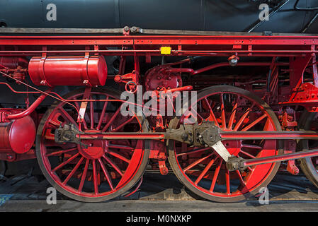 Driving wheels of the 39 230,first old-style locomotive in a former railway depot,Bavaria,Germany - Stock Photo