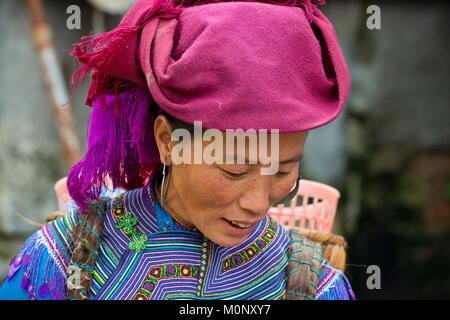 Woman in traditional dress of the Flower Hmong,Sunday market,Bac Ha,North Vietnam,Vietnam - Stock Photo