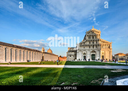 The Camposanto Monumentale and the Duomo, Pisa Cathedral in the Piazza dei Miracoli in Pisa Italy as the Baptistry - Stock Photo
