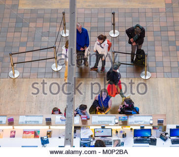 People standing in line to purchase tickets to special exhibits inside the main hall of the Science Museum, Kensington - Stock Photo