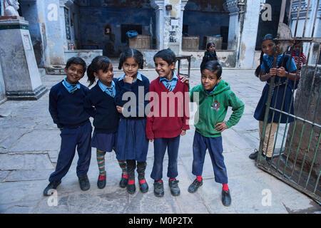 Schoolkids in blue, Bundi, Rajasthan, India - Stock Photo