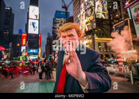 United States,New York,New York City,Mid-Town Manhattan,Times Square,man in Donald Trump mask - Stock Photo