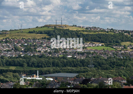 Hillside suburban area with housing, green fields, woodland & transmitters  on sunny day - Shipley & Wrose areas - Stock Photo