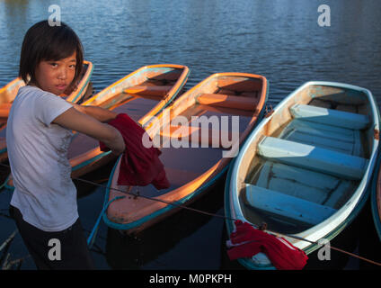 North Korean girl washing her clothes in the lake of the Songdowon international children's camp, Kangwon Province, - Stock Photo