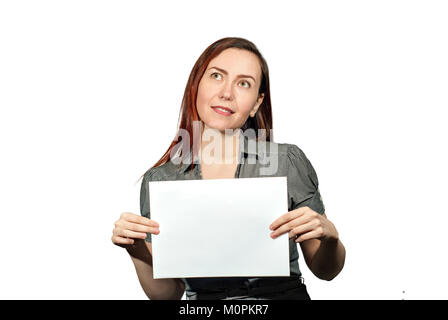 girl on a white background holds a blank empty white rectangle, looks past the frame up and mysteriously smiles - Stock Photo