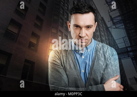 Mad young man showing his temper into camera - Stock Photo