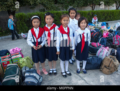 North Korean pioneers arriving in the Songdowon international children's camp, Kangwon Province, Wonsan, North Korea - Stock Photo