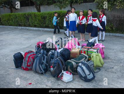 North Korean pioneers arriving in Songdowon international children's camp, Kangwon Province, Wonsan, North Korea - Stock Photo