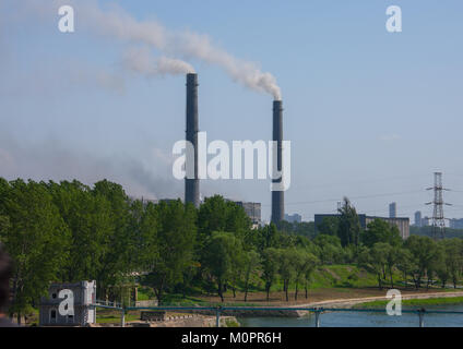 Pollution of a coal factory in the town, Pyongan Province, Pyongyang, North Korea - Stock Photo