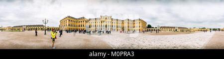 Unidentified people walking around Schonbrunn Palace in Vienna - Stock Photo